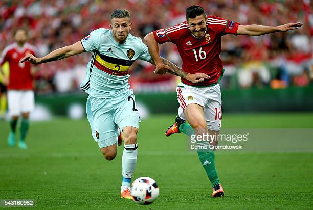 Toby Alderweireld of Belgium and Adam Pinter of Hungary compete for the ball during the UEFA EURO 2016 round of 16 match bewtween Hungary and Belgium...