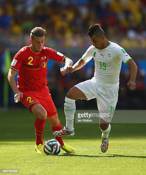 Toby Alderweireld of Belgium challenges Saphir Taider of Algeria during the 2014 FIFA World Cup Brazil Group H match between Belgium and Algeria at...