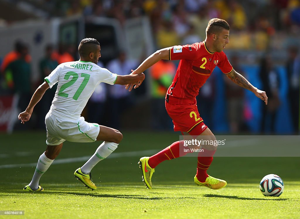 Toby Alderweireld of Belgium controls the ball against Riyad Mahrez of Algeria during the 2014 FIFA World Cup Brazil Group H match between Belgium...