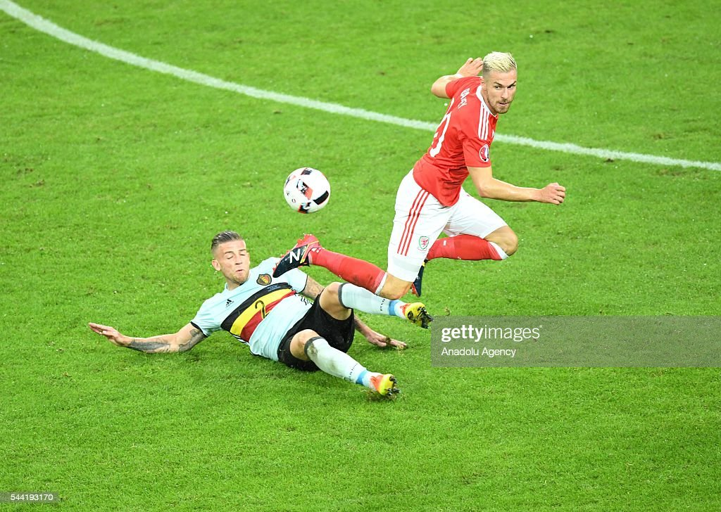 Toby Alderweireld (L) of Belgium in action against Aaron Ramsey (R) of Wales during the Euro 2016 quarter-final football match between Wales and Belgium at the Stadium Pierre Mauroy in Lille, France on July 1, 2016.