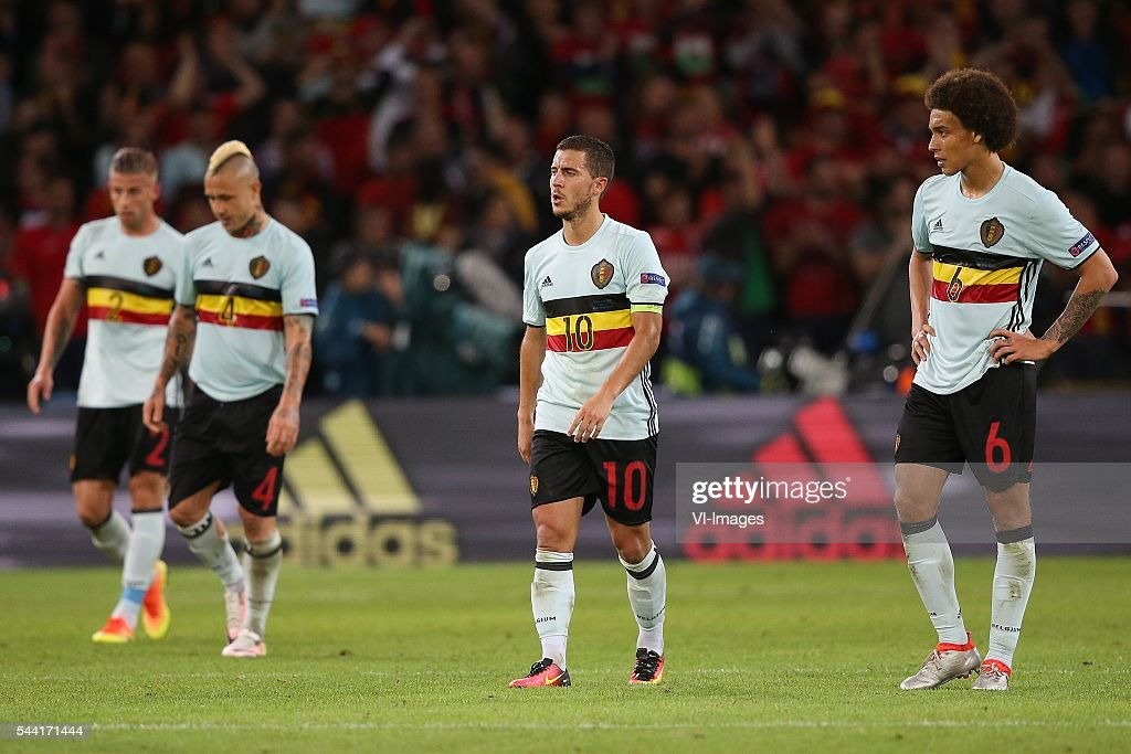 Toby Alderweireld of Belgium, Radja Nainggolan of Belgium, Eden Hazard of Belgium, Axel Witsel of Belgium disappointed during the UEFA EURO 2016 quarter final match between Wales and Belgium on July 2, 2016 at the Stade Pierre Mauroy in Lille, France.