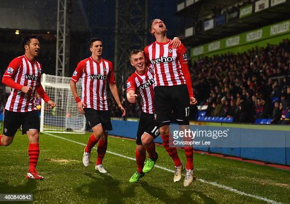 Toby Alderweireld of Southampton celebrates with team mates Maya Yoshida Florin Gardos and James WardProwse as he scores their third goal during the...