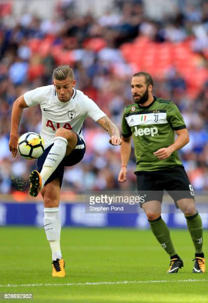 Toby Alderweireld of Tottenham Hotspur and Gonzalo Higuain of Juventus compete for the ball during the PreSeason Friendly match between Tottenham...