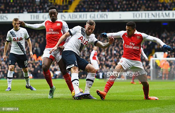 Toby Alderweireld of Tottenham Hotspur battles with Danny Welbeck and Alexis Sanchez of Arsenal during the Barclays Premier League match between...