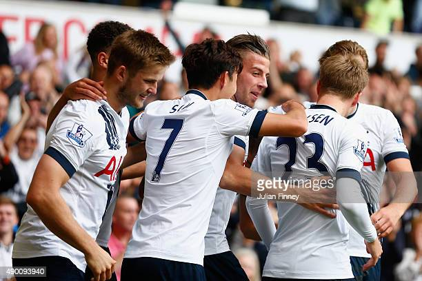 Toby Alderweireld of Tottenham Hotspur celebrates scoring his team's first goal with his team mates during the Barclays Premier League match between...