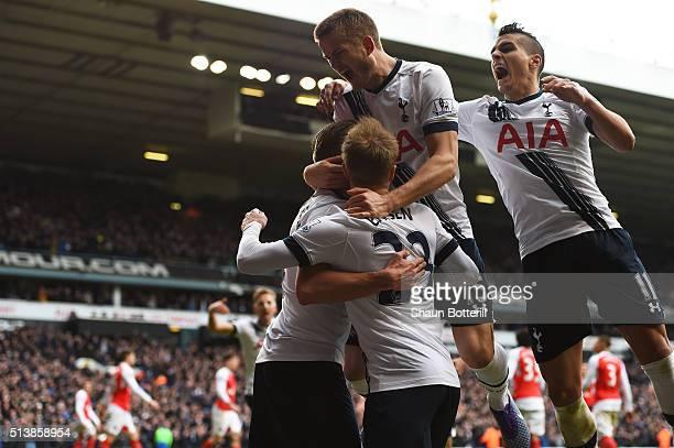 Toby Alderweireld of Tottenham Hotspur celebrates scoring his team's first goal with his team mates Christian Eriksen Eric Dier and Erik Lamela...