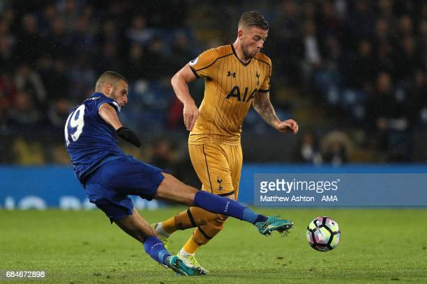 Toby Alderweireld of Tottenham Hotspur is challenged by Islam Slimani of Leicester City during the Premier League match between Leicester City and...