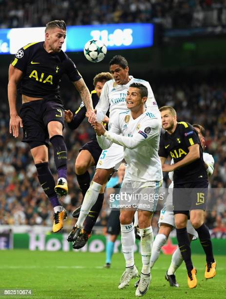 Toby Alderweireld of Tottenham Hotspur Raphael Varane of Real Madrid and Cristiano Ronaldo of Real Madrid all battle to win a header during the UEFA...