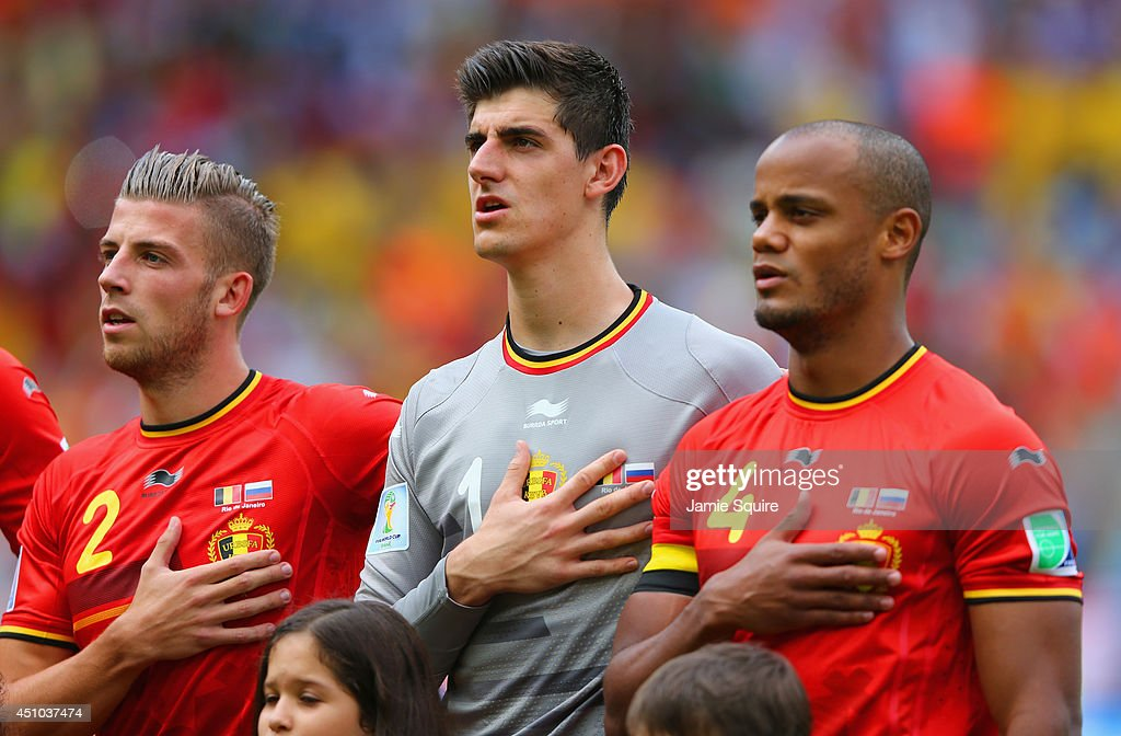 Toby Alderweireld, Thibaut Courtois and Vincent Kompany of Belgium sing the National Anthem prior to the 2014 FIFA World Cup Brazil Group H match between Belgium and Russia at Maracana on June 22, 2014 in Rio de Janeiro, Brazil.