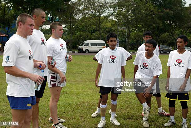 Toby Arnold far left of the HSBC Penguin during the HSBC Coaching Clinics at the COBRA 10s' Rugby Club on October 30 2008 in Kuala Lumpur Malaysia...