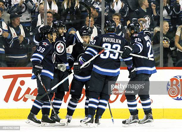 Toby Enstrom Andrew Ladd Bryan Little Dustin Byfuglien and Blake Wheeler of the Winnipeg Jets celebrate a first period goal against the Minnesota...