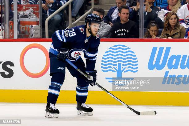 Toby Enstrom of the Winnipeg Jets gets set for a second period faceoff against the Toronto Maple Leafs at the Bell MTS Place on October 4 2017 in...