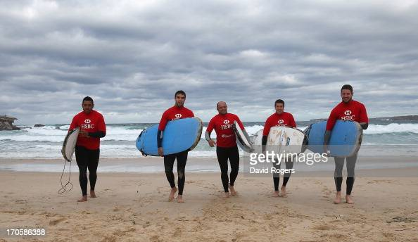 Toby Faletau Conor Murray Rory Best Justin Tipuric and Alex Cuthbert of the British Irish Lions walk up the bear with their surfboards during surfing...