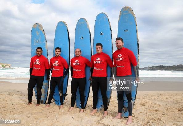 Toby Faletau Conor Murray Rory Best Justin Tipuric and Alex Cuthbert of the British Irish Lions pose with their surfboards during surfing lessons on...