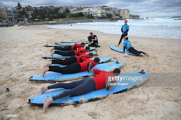 Toby Faletau Conor Murray Rory Best Justin Tipuric and Alex Cuthbert of the British Irish Lions lie on their surfboards during surfing lessons on...