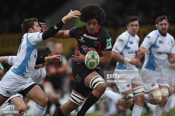Toby Faletau of Newport drops the ball as DTH van der Merwe challenges during the Heineken Cup Round Six match between Newport Gwent Dragons and...