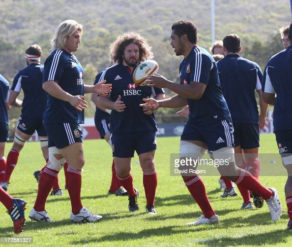 Toby Faletau passes the ball to Richard Hibbard as Adam Jones looks on during a British Irish Lions training session at Noosa Dolphins RFA on July 4...