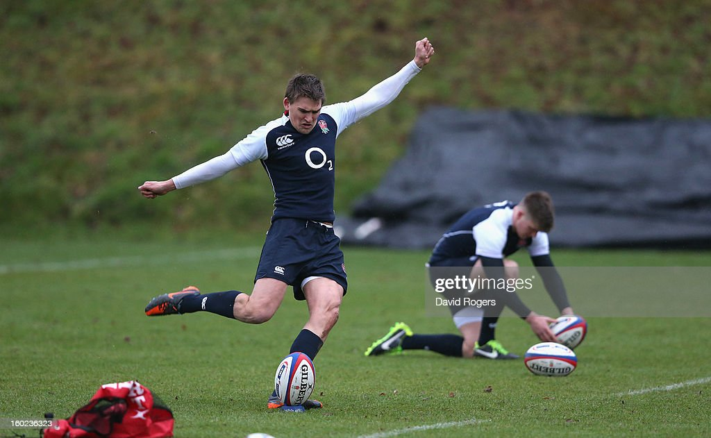 Toby Flood (L) and Owen Farrell, practice their kicking during the England training session held at Pennyhill Park on January 28, 2013 in Bagshot, England.