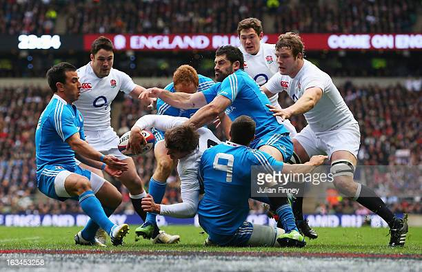 Toby Flood of England is tackled by the Edoardo Gori and Andrea Masi of Italy near the try line during the RBS Six Nations match England and Italy at...