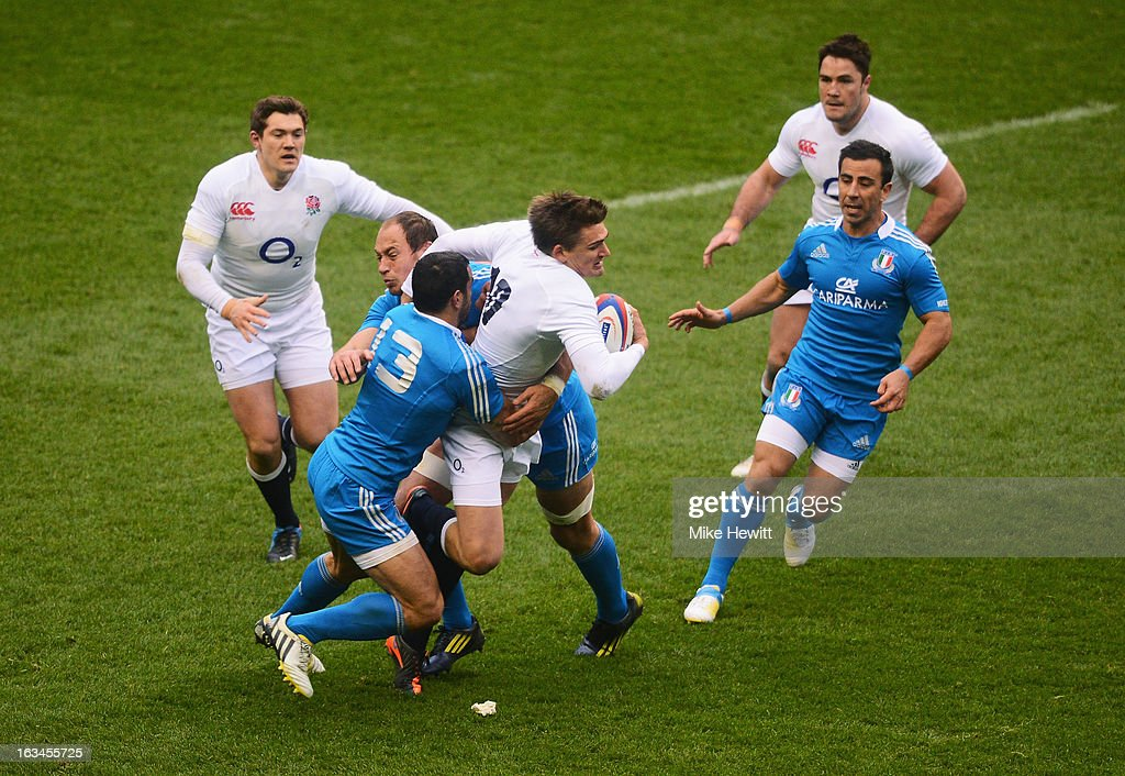 Toby Flood of England runs into Gonzalo Canale of Italy and Sergio Parisse of Italy during the RBS Six Nations match England and Italy at Twickenham Stadium on March 10, 2013 in London, England.