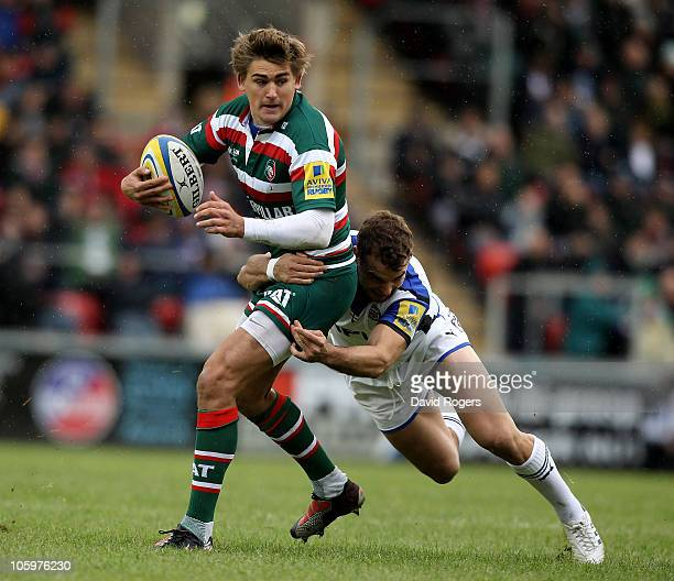 Toby Flood of Leicester is tackled by Olly Barkley during the Aviva Premiership match between Leicester Tigers and Bath at Welford Road on October 23...