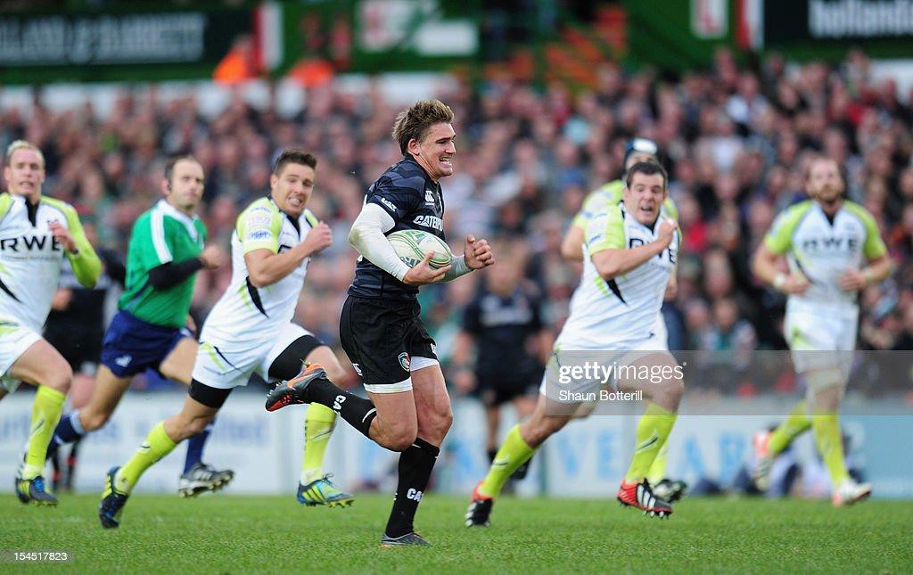<a gi-track='captionPersonalityLinkClicked' href=/galleries/search?phrase=Toby+Flood&family=editorial&specificpeople=551191 ng-click='$event.stopPropagation()'>Toby Flood</a> of Leicester Tigers breaks through to score during the Heineken Cup Round 2 match between Leicester Tigers and Ospreys at Welford Road on October 21, 2012 in Leicester, England.