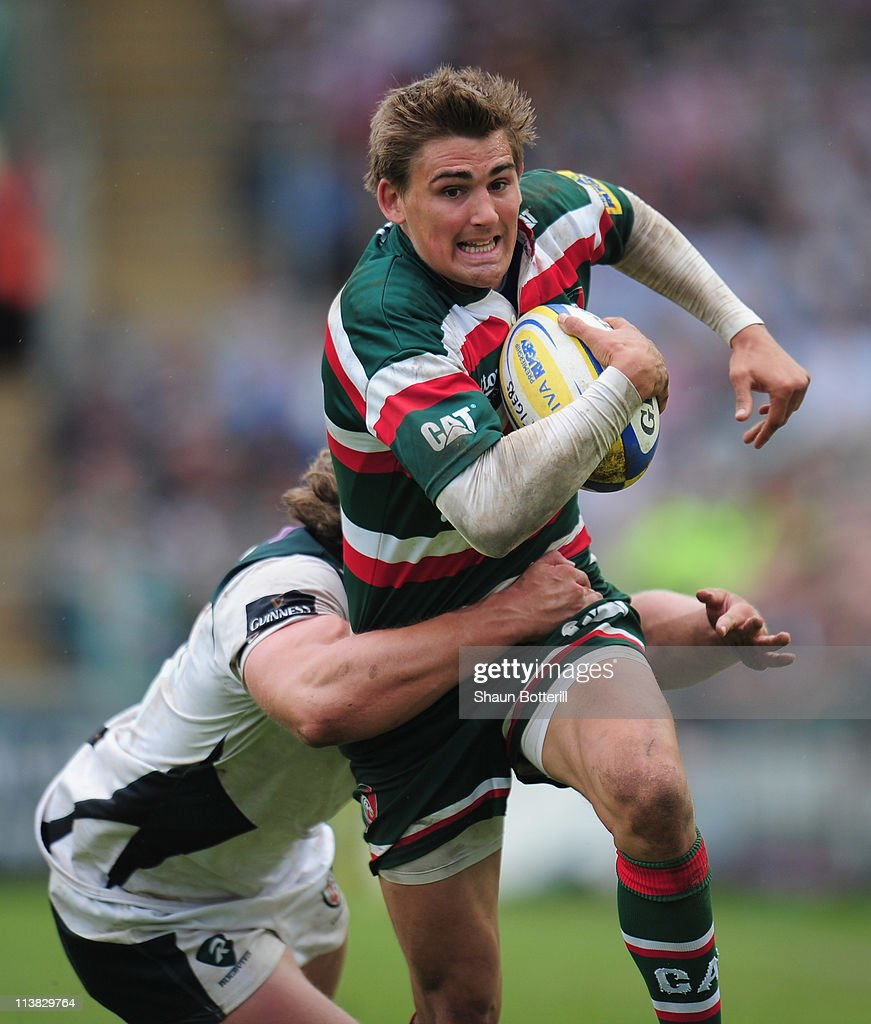 Toby Flood of Leicester Tigers is tackled by Max Lahiff of London Irish during the AVIVA Premiership match between Leicester Tigers and London Irish...