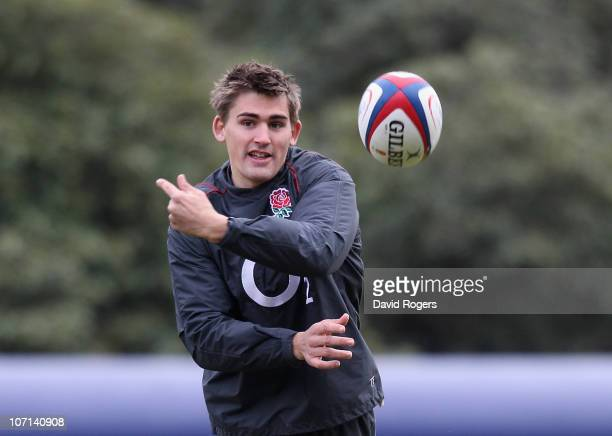 Toby Flood passes the ball during the England training session held at the Pennyhill Park Hotel on November 25 2010 in Bagshot England