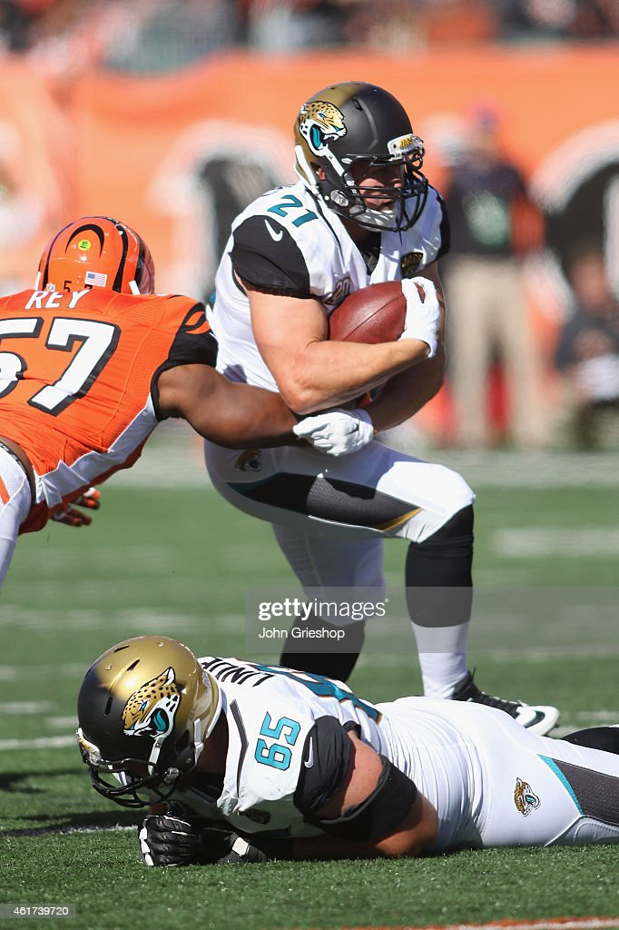 ... Toby Gerhart 21 of the Jacksonville Jaguars runs the football upfield  during the game against Jacksonville Jaguars 8 Jalen Ramsey Nike Teal Green  Elite ... 2ea6c9599