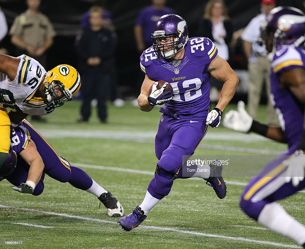 Toby Gerhart #32 of the Minnesota Vikings carries the ball during an NFL game against the Green Bay Packers at Mall of America Field at the Hubert H. Humphrey Metrodome on October 27, 2013 in Minneapolis, Minnesota.