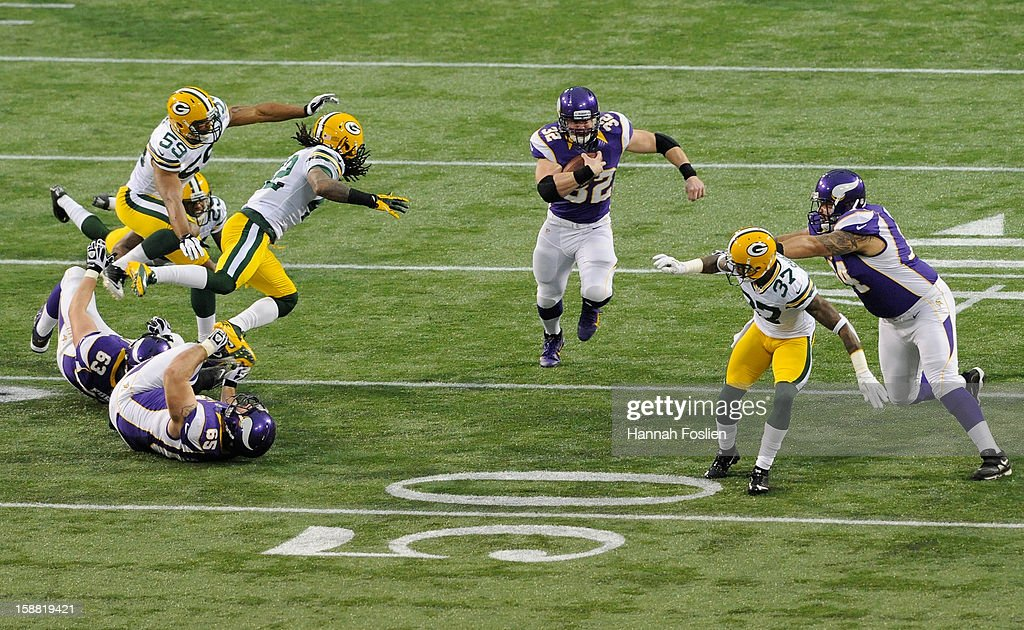Toby Gerhart #32 of the Minnesota Vikings carries the ball during the first quarter of the game against the Green Bay Packers on December 30, 2012 at Mall of America Field at the Hubert H. Humphrey Metrodome in Minneapolis, Minnesota.