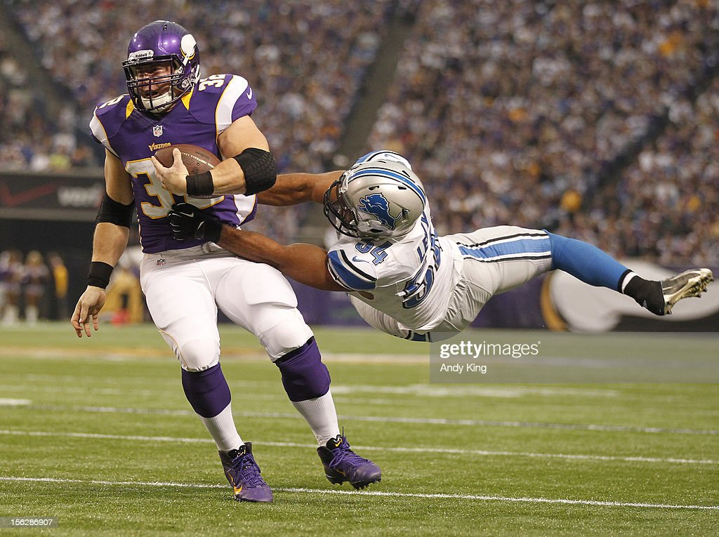 Toby Gerhart #32 of the Minnesota Vikings makes a move on DeAndre Levy #54 of the Detroit Lions on November 11, 2012 at Mall of America Field at the Hubert H. Humphrey Metrodome in Minneapolis, Minnesota.