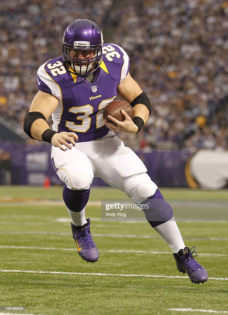Toby Gerhart #32 of the Minnesota Vikings runs against the Detroit Lions on November 11, 2012 at Mall of America Field at the Hubert H. Humphrey Metrodome in Minneapolis, Minnesota.