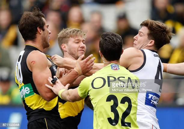 Toby Greene of the Giants and Alex Rance of the Tigers clash during the 2017 AFL round 18 match between the Richmond Tigers and the GWS Giants at the...