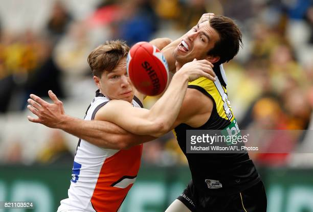 Toby Greene of the Giants and Alex Rance of the Tigers compete for the ball during the 2017 AFL round 18 match between the Richmond Tigers and the...