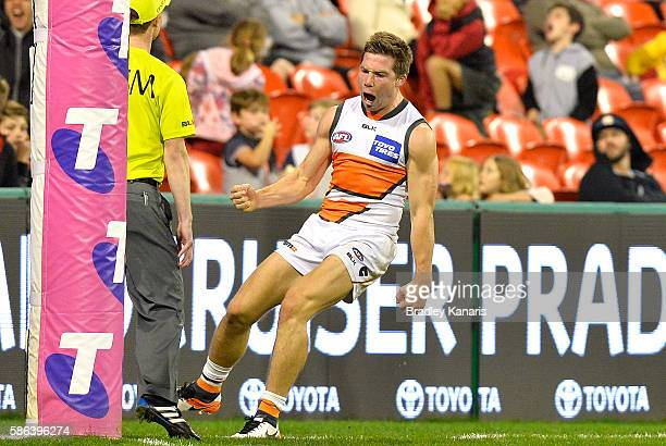Toby Greene of the Giants celebrates kicking a goal during the round 20 AFL match between the Gold Coast Suns and the Grater Western Sydney Giants at...