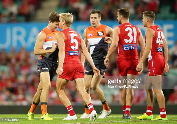 Toby Greene of the Giants clashes with Isaac Heeney of the Swans during the round five AFL match between the Sydney Swans and the Greater Western...