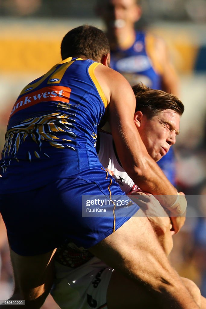 Toby Greene of the Giants gets tackled by Will Schofield of the Eagles during the round 10 AFL match between the West Coast Eagles and the Greater Western Giants at Domain Stadium on May 28, 2017 in Perth, Australia.