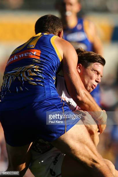 Toby Greene of the Giants gets tackled by Will Schofield of the Eagles during the round 10 AFL match between the West Coast Eagles and the Greater...