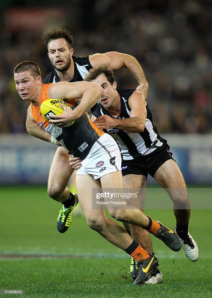 Toby Greene of the Giants is tackled by Steele sidebottom of the Magpies during the round 18 AFL match between the Collingwood Magpies and the Greater Western Sydney Giants at Melbourne Cricket Ground on July 27, 2013 in Melbourne, Australia.