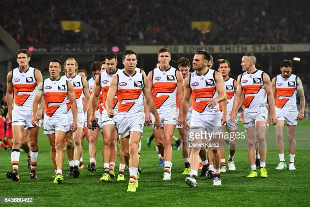 Toby Greene of the Giants leads his team mates from the field at half time during the AFL First Qualifying Final match between the Adelaide Crows and...