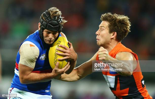 Toby Greene of the Giants makes a late hit on Caleb Daniel of the Bulldogs during the round six AFL match between the Greater Western Sydney Giants...