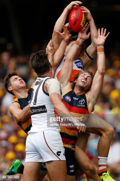 Toby Greene of the Giants marks over Daniel Talia of the Crows during the 2017 AFL round 01 match between the Adelaide Crows and the GWS Giants at...