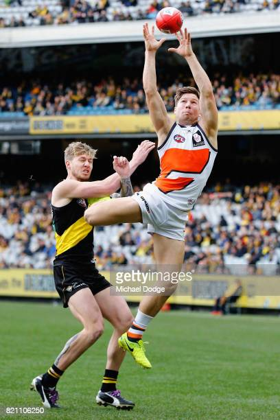 Toby Greene of the Giants marks the ball against Nathan Broad of the Tigers during the round 18 AFL match between the Richmond Tigers and the Greater...