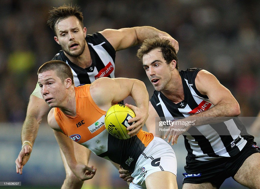 Toby Greene of the Giants runs with the ball during the round 18 AFL match between the Collingwood Magpies and the Greater Western Sydney Giants at Melbourne Cricket Ground on July 27, 2013 in Melbourne, Australia.