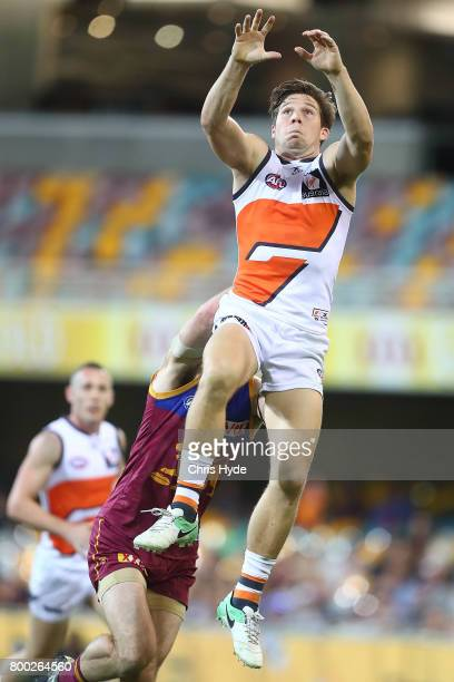 Toby Greene of the Giants takes a mark during the round 14 AFL match between the Brisbane Lions and the Greater Western Sydney Giants at The Gabba on...