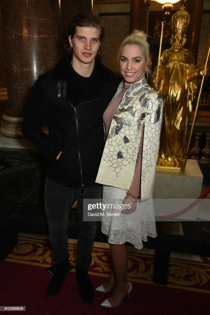 Toby Huntington Whiteley and Amber Le Bon attend the Julien Macdonald show during the London Fashion Week February 2017 collections on February 18, 2017 in London, England.
