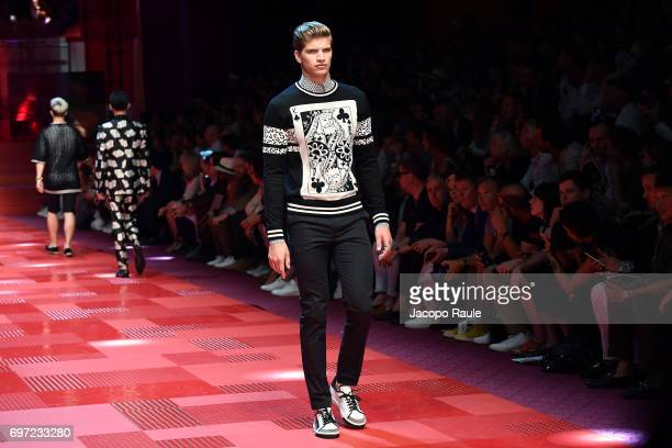 Toby Huntington Whiteley walks the runway at the Dolce Gabbana show during Milan Men's Fashion Week Spring/Summer 2018 on June 17 2017 in Milan Italy
