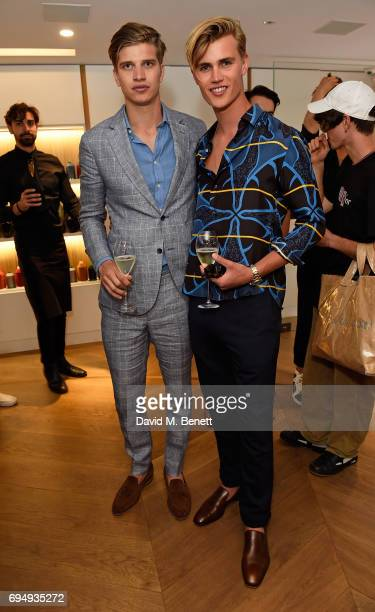 Toby HuntingtonWhitely and Samuel Harwood attend the Aston Martin x Hogan London Fashion Week Men's Cocktail in partnership with GQ Style on June 11...