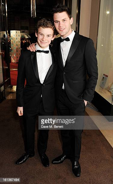 Toby Irvine and Jeremy Irvine arrive at the EE British Academy Film Awards at the Royal Opera House on February 10 2013 in London England